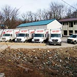Jay Kay Gutter Supply's large fleet of gutter supply delivery trucks